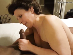 Amateur granny filmed by cuck with her black lover