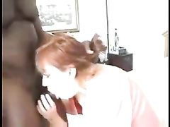 Redhead plump wife gets filmed by hubby while taking mandingo