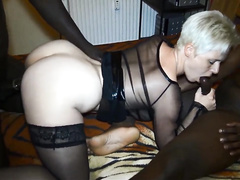 Blonde German milf in lingerie worships two big black cocks